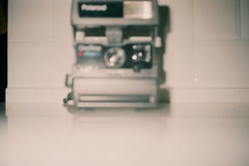 Gray and Black Polaroid Camera