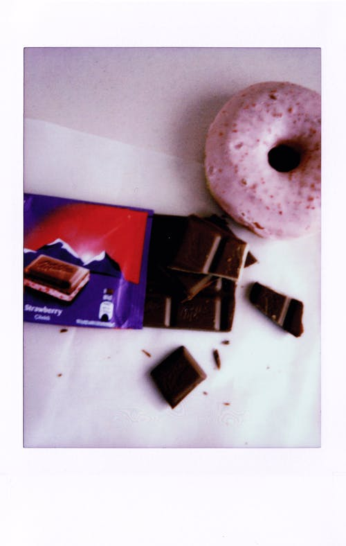 Chocolate Bar With Strawberry  And Strawberry Doughnut on White Table