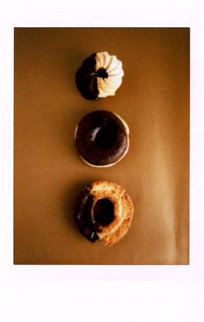 Variety of doughnuts on brown surface