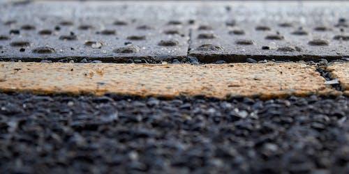 Foto d'estoc gratuïta de asfalt, groc, línia, negre
