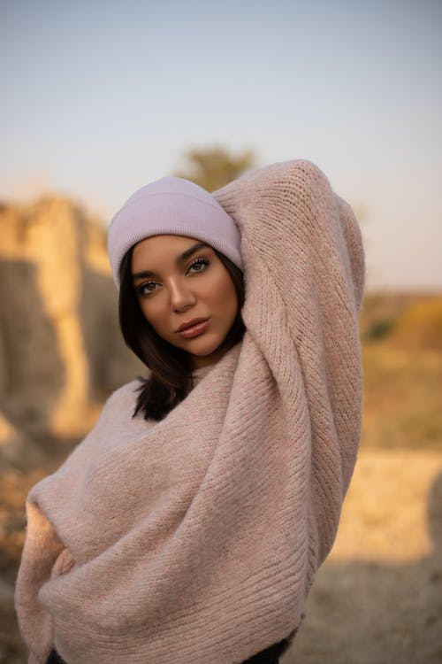 Woman in White Knit Cap and Gray Sweater