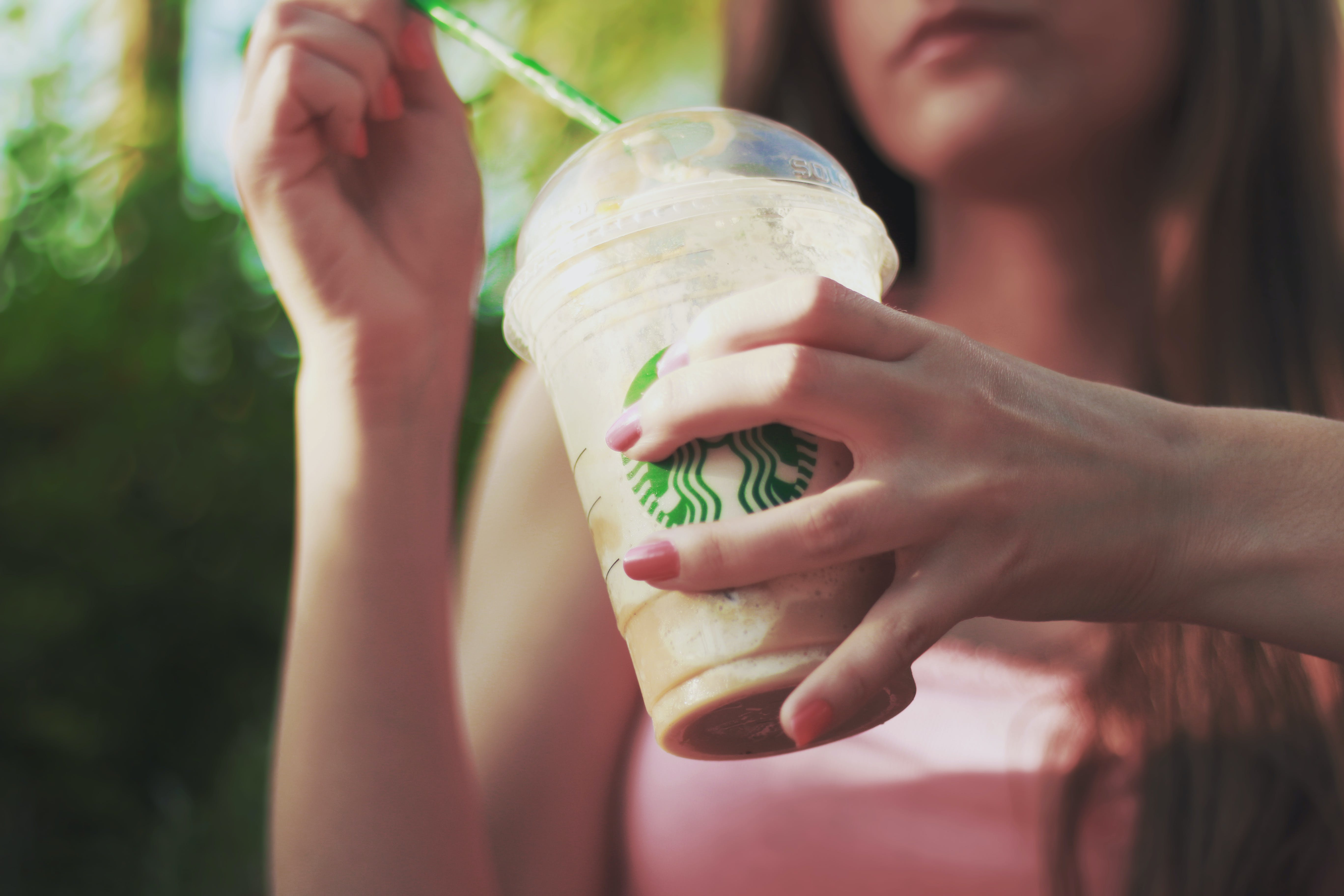 Woman Holding Starbucks Coffee Cup