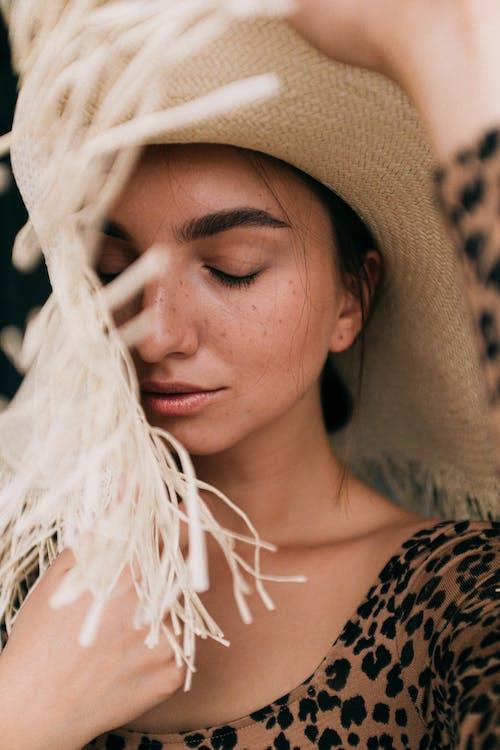 Photo of Woman Wearing Straw Hat