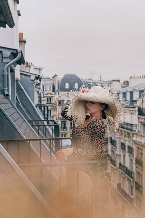 Photo Of Woman Leaning On Handrail