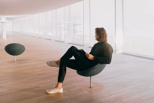 Photo Of Man Sitting On Chair