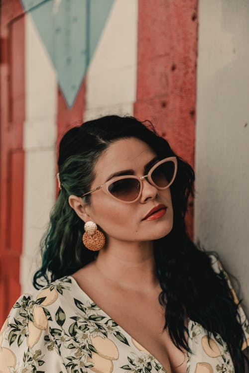 Woman in White and Black Floral Shirt Wearing Sunglasses