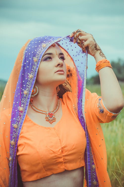 Woman in Orange and Blue Sari Dress