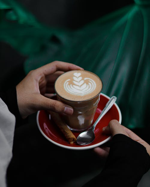 Person Holding Coffee Latte