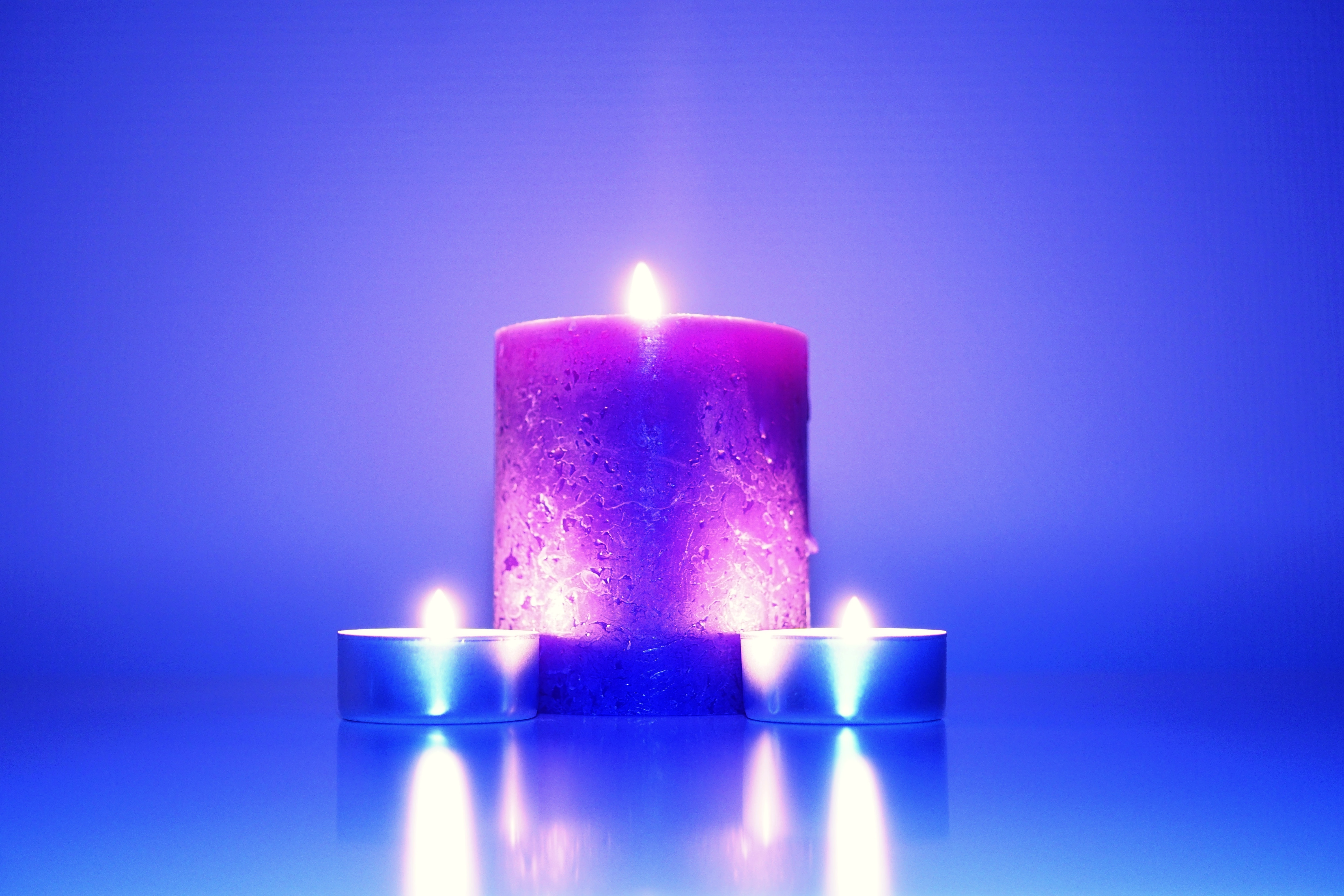 Three Lighted Candles Free Stock Photo