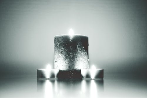 Photography of Three Lighted Candles