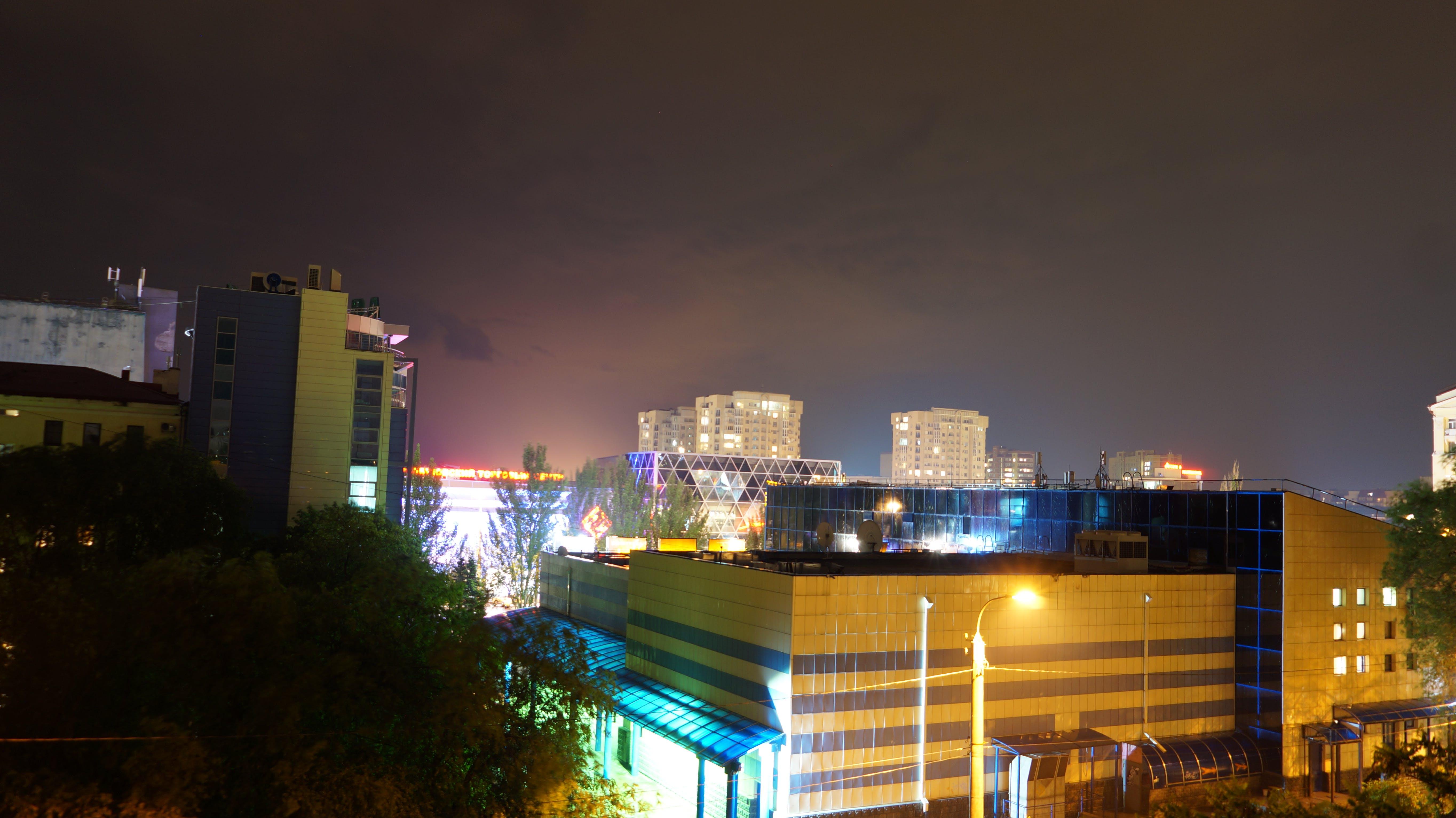 Free stock photo of city, lights, night, cloudy