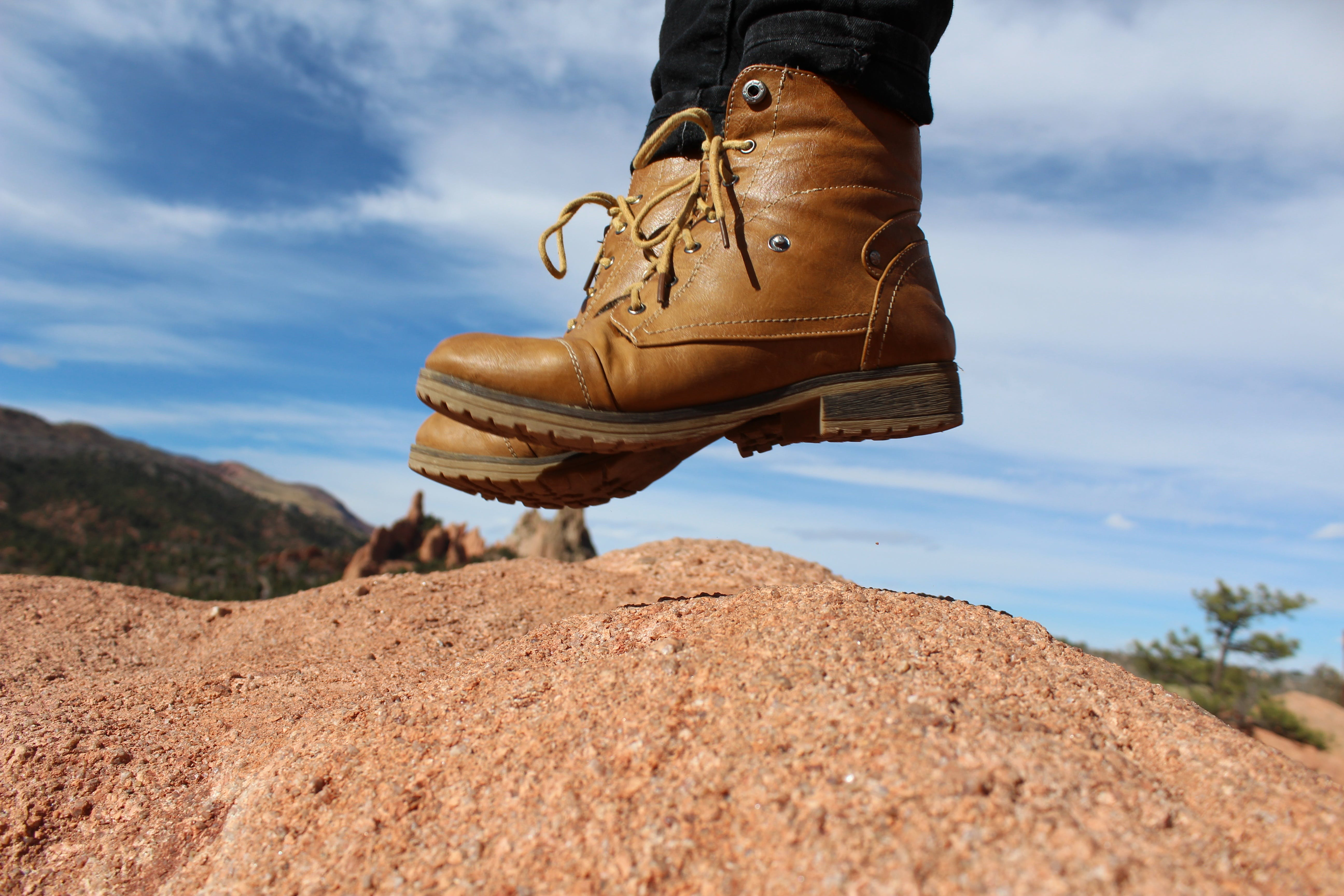 Person Wearing Brown Leather Work Boots during Daytime