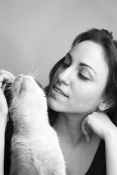 Grayscale Photo of Woman and Cat