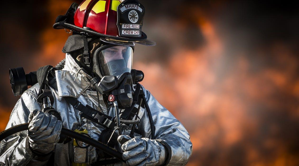 Shallow Focus Photography of Fireman