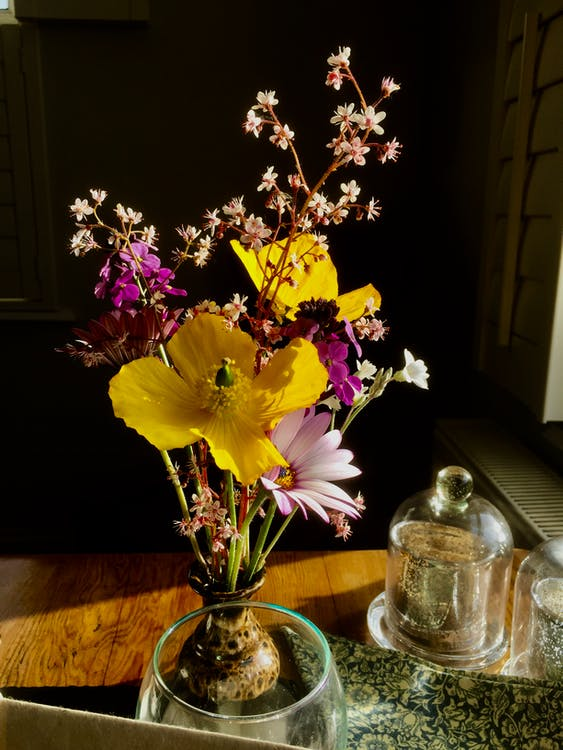 Yellow and Pink Flowers in Clear Glass Vase
