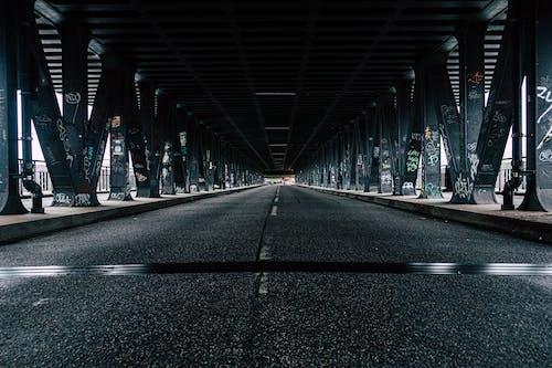 Black Asphalt Road Under Bridge
