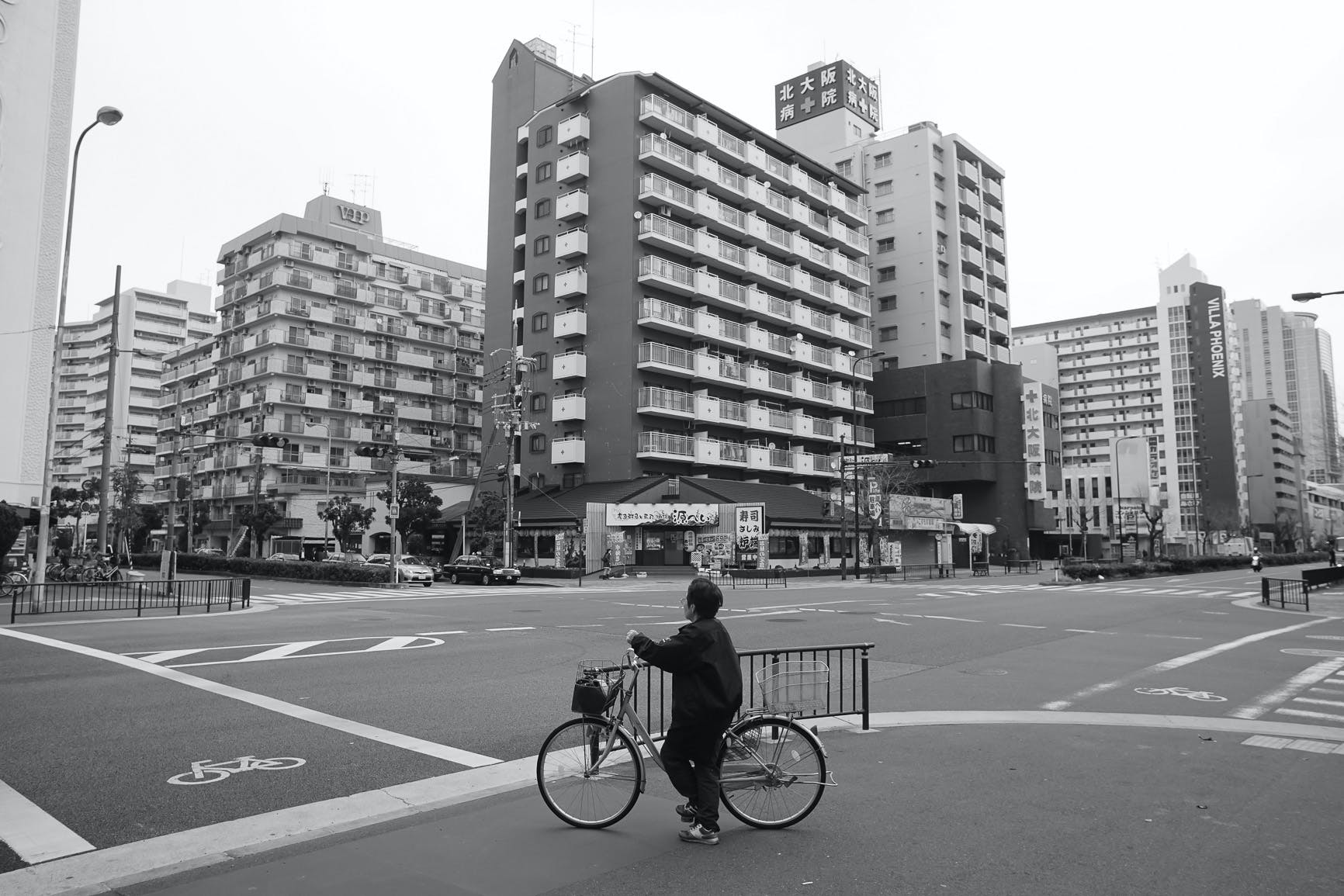 Free stock photo of bicycle, black and white, buildings, city life