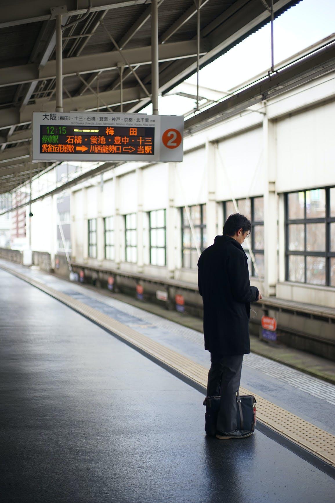Man Standing Near Subway Station