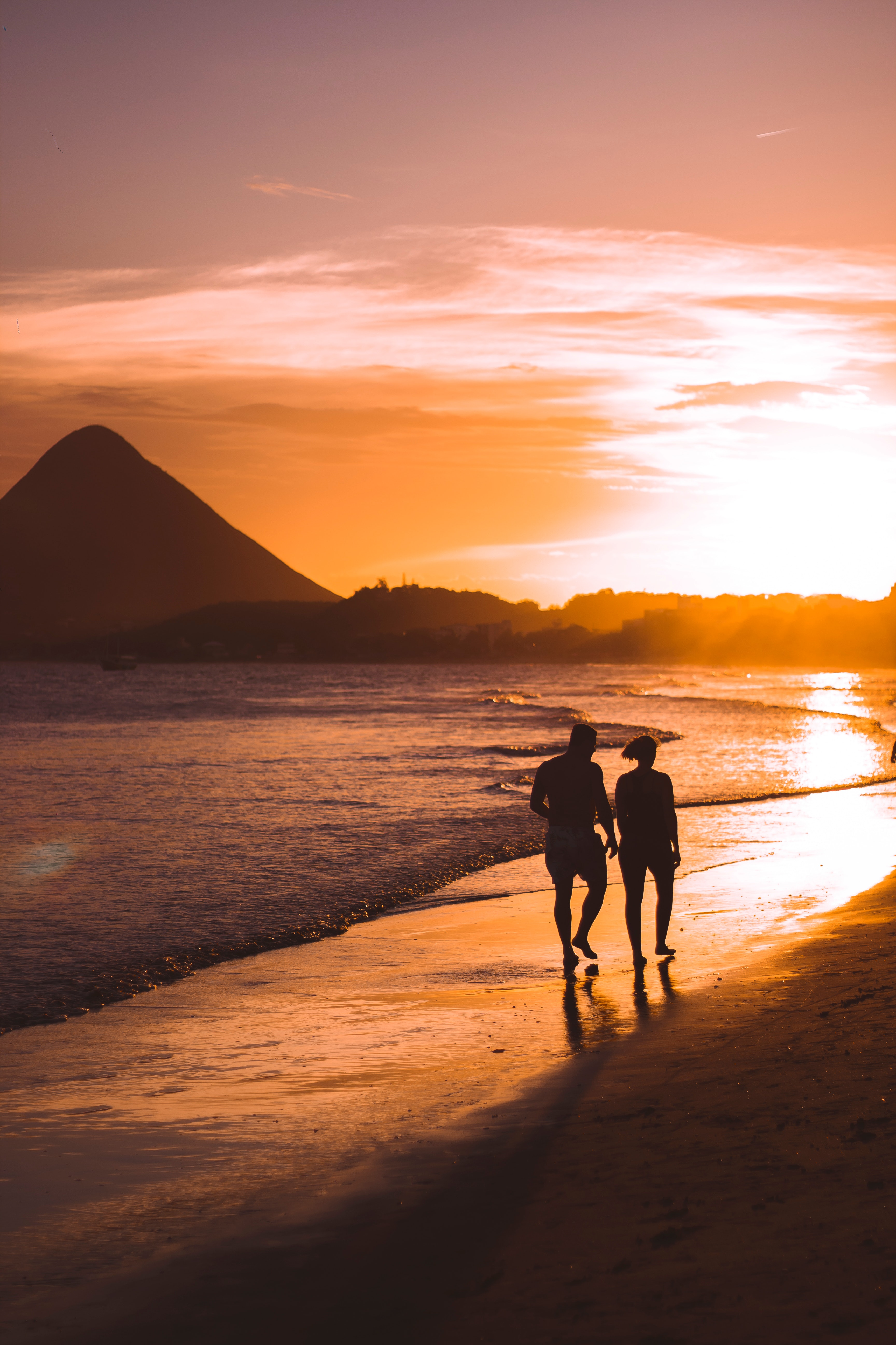 Silhouette of Two People Walking on Beach during Sunset ...