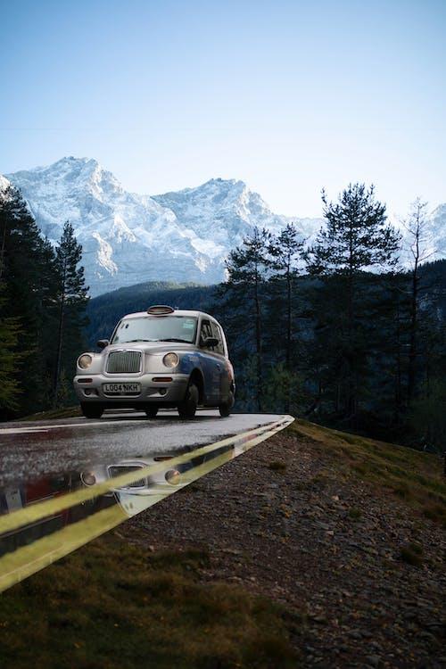White Porsche 911 on Road Near Snow Covered Mountain