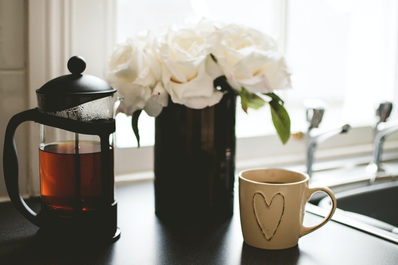 Beige Ceramic Mug With Coffee on Table