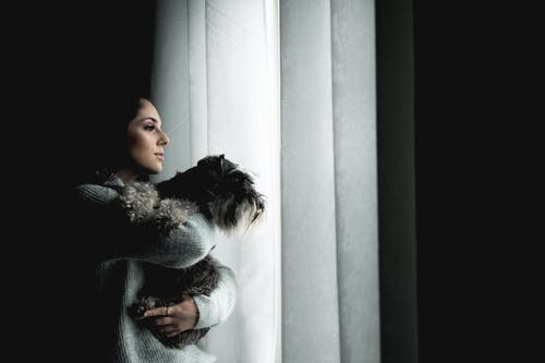 Photo Of Woman Holding Dog