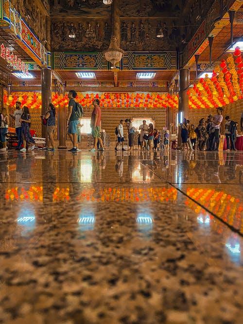 People Walking Inside Temple