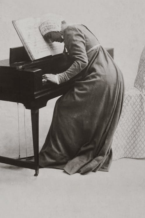 Old Photo Of Woman Playing Piano