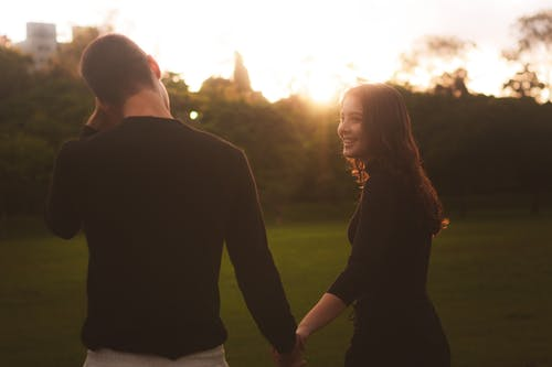 Free stock photo of couple, evening sun, photographs, smile