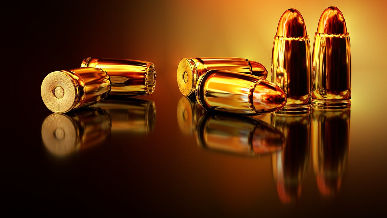 Six Brass Rifle Bullets