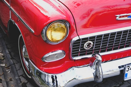 Red and Silver Car With Headlight
