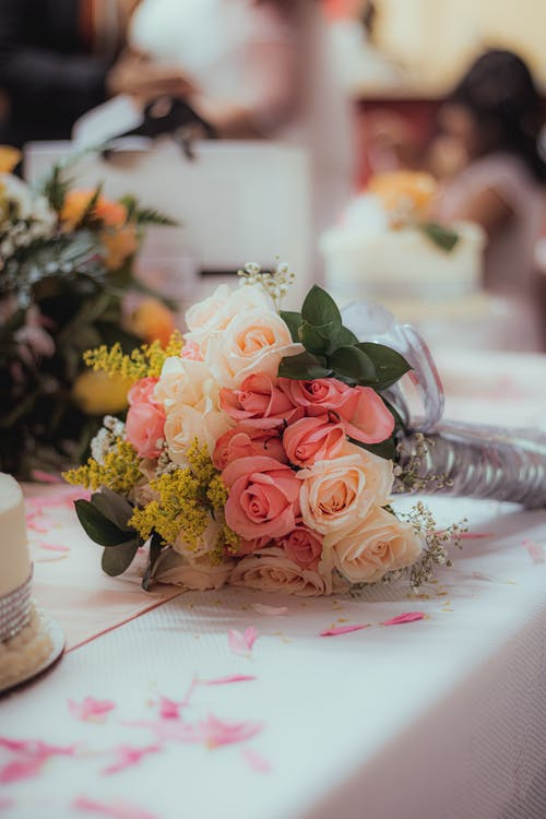 Pink Roses Bouquet on White Table