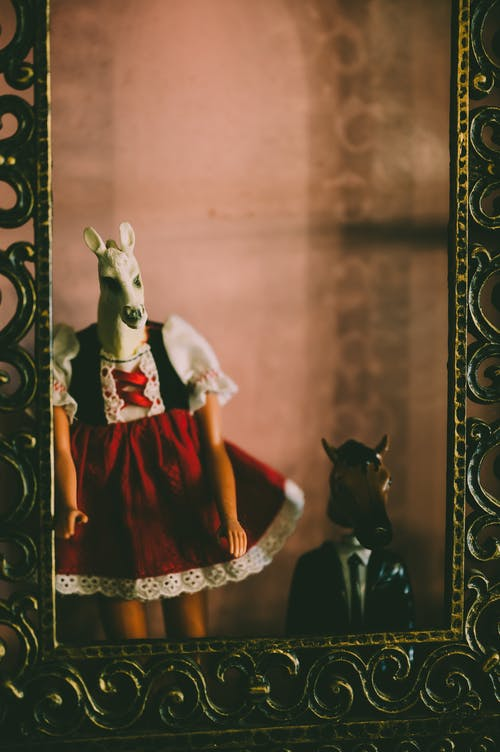 Woman in Red Dress with Horse Head