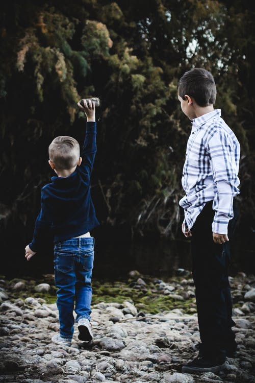 Boys Playing with Rocks