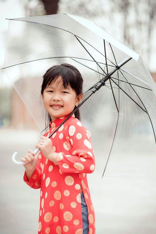 Asian Girl Holding a Umbrella