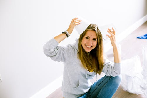 Photo of Woman Wearing Gray Hoodie
