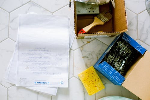 Papers, Sponge and Boxes on the Floor