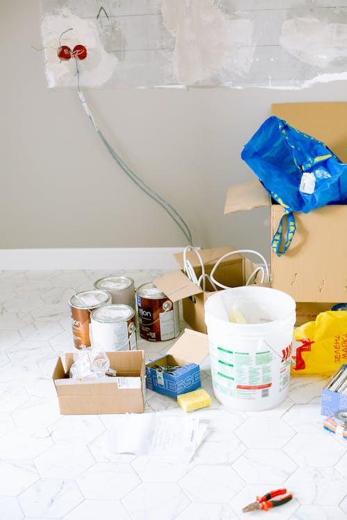 Blue Plastic on Brown Cardboard Box