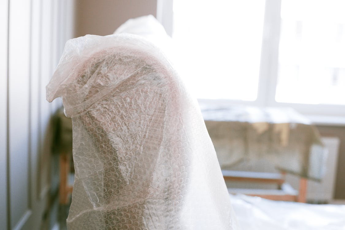 Shallow Focus Photo of Furniture With Bubble Wrap