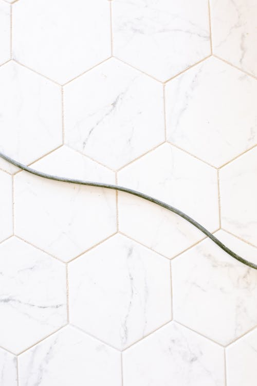 Black Wire on White Floor