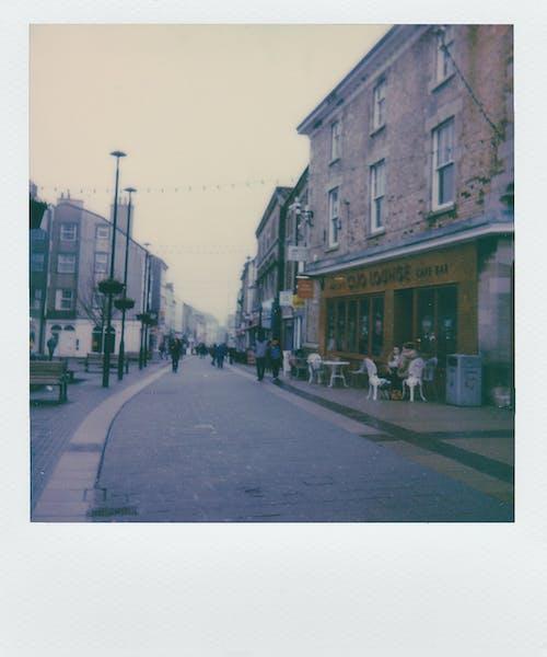 Photo of People Walking on Street