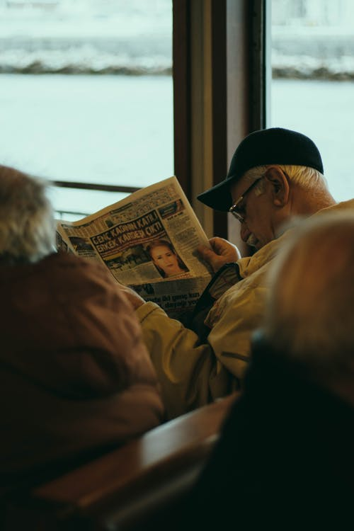 Man in Brown Jacket Sitting Beside Woman in Brown Jacket
