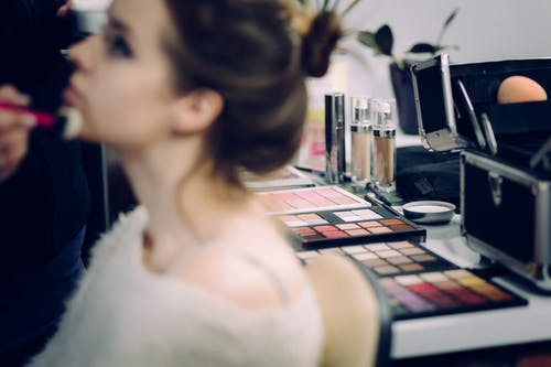 Woman Sitting Doing Makeup