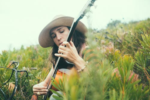 Photo of a Woman Playing Guitar
