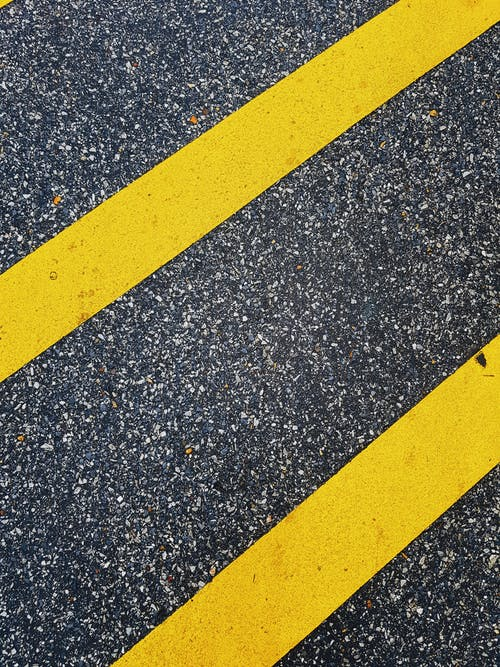 Yellow and Black Lines on Gray Concrete Pavement