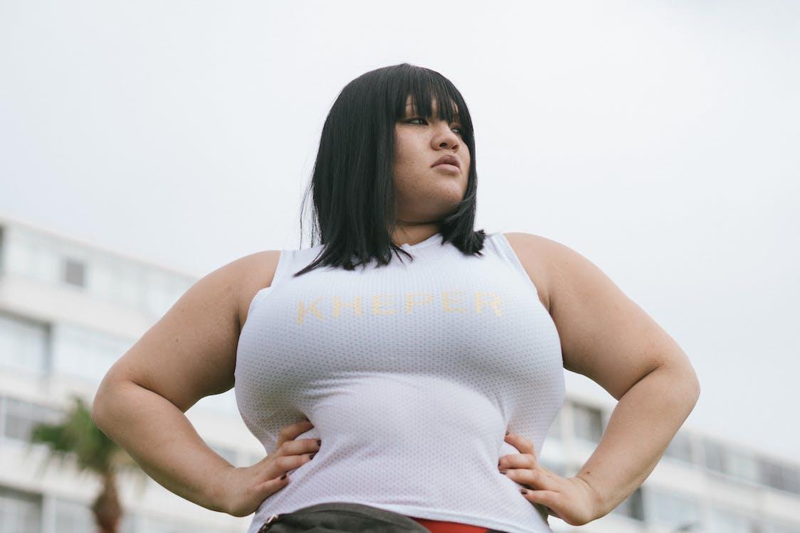 Photo Of Woman Wearing White Tank Top