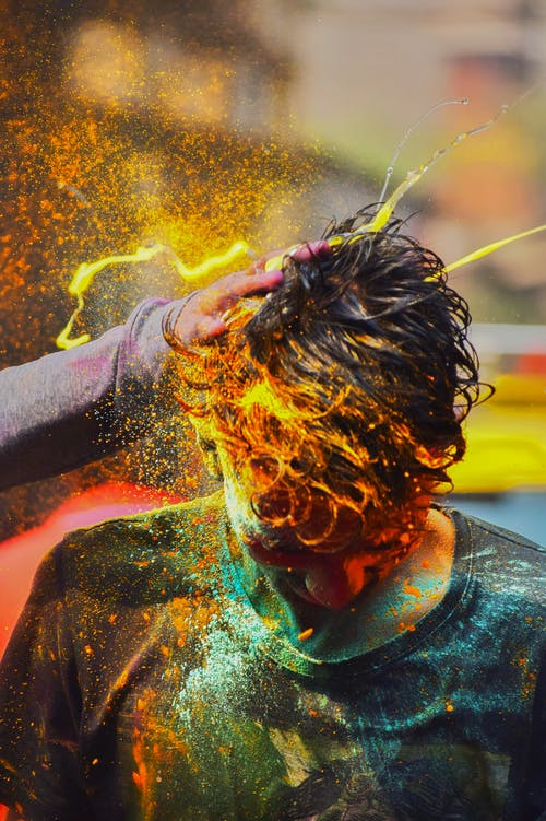Man with Colorful Powder on His Head