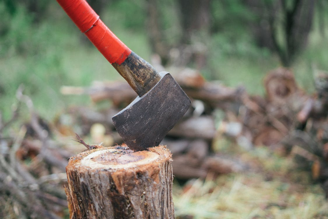 Photo Of Axe On Wooden Log