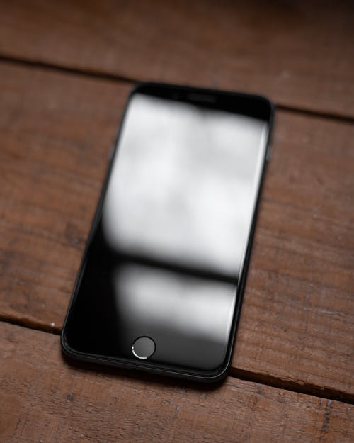 Photo Of Smartphone On Wooden Surface