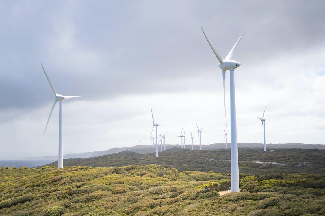 Photo Of Wind Turbines Under Cloudy Sky
